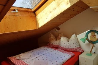 Double bedroom with roof pitch and mountain view