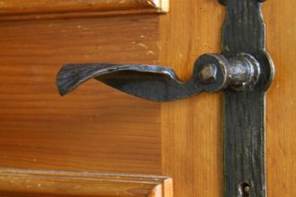 Traditional door handles adorn the house